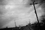 Due to the overwhelming lack of services provided to those residents, almost all African American,  of the hard hit Lower 9th Ward of New Orleans, cars, abandoned homes and trash still fill the neighborhood 6 months after Hurricane Katrina.. Cranes and ruined telephone poles line the edge of the levee that broke in the storm destroying the neighborhood.