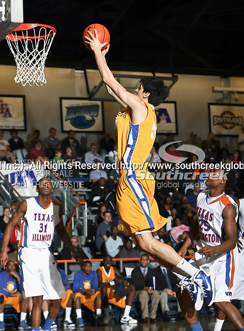 McNeese State Cowboys forward Daniel Richard (54) in action during the NCAA basketball game between the McNeese State Cowboys and the UTA Mavericks held at the University of Texas at Arlington's, Texas Hall, in Arlington, Texas.  McNeese State defeats UTA 81 to 72.