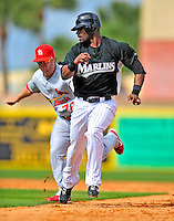 1 March 2009: Florida Marlins' outfielder Jai Miller is caught in a rundown during a Spring Training game against the St. Louis Cardinals at Roger Dean Stadium in Jupiter, Florida. The Cardinals outhit the Marlins 20-13 resulting in a 14-10 win for the Cards. Mandatory Photo Credit: Ed Wolfstein Photo