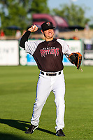 Wisconsin Timber Rattlers first baseman KJ Harrison (24) warms up in the outfield prior to a Midwest League game against the Clinton LumberKings on June 29, 2018 at Fox Cities Stadium in Appleton, Wisconsin. Clinton defeated Wisconsin 9-7. (Brad Krause/Four Seam Images)