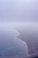 View out of airplane window of shoreline<br />