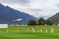 20th November 2020; John Davies Oval, Queenstown, Otago, South Island of New Zealand. New Zealand A versus  West Indies; wide view of the field of play as New Zealand bat and a plane takes off from the airport