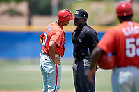 GCL Phillies West manager Nelson Prada (57) argues with umpire Tre Jester after being ejected during a game against the GCL Blue Jays on August 7, 2018 at Bobby Mattick Complex in Dunedin, Florida.  GCL Blue Jays defeated GCL Phillies West 11-5.  (Mike Janes/Four Seam Images)