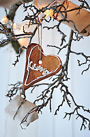 One of the gingerbread hearts that hangs from the pear tree branch in the dining area