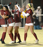 NWA Democrat-Gazette/ANDY SHUPE<br /> Arkansas' Parker Goins (right) is congratulated Friday, Nov. 15, 2019, by teammates after Goins scored the Razorbacks' second goal during the second half of play against North Texas in the first round of the NCAA women's soccer tournament at Razorback Field in Fayetteville. Visit nwadg.com/photos to see more photographs from the match.