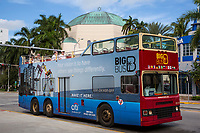 Miami, Florida.  Big Bus Passing by Emanu-El Temple.