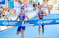 20 JUL 2013 - HAMBURG, GER - Alistair Brownlee (GBR) (right) of Great Britain can only watch as he is out sprinted to the finish line by his younger brother Jonathan Brownlee (GBR) at the elite men's ITU 2013 World Triathlon Series round in the Altstadt Quarter in Hamburg, Germany (PHOTO COPYRIGHT © 2013 NIGEL FARROW, ALL RIGHTS RESERVED)