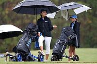 CHAPEL HILL, NC - OCTOBER 13: Miranda Wang of Duke University checks the rain at UNC Finley Golf Course on October 13, 2019 in Chapel Hill, North Carolina.