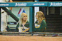 Two of the Baylor Bears bat girls watch the game against the Utah Utes from the home dugout at Minute Maid Park on March 5, 2011 in Houston, Texas.  Photo by Brian Westerholt / Four Seam Images
