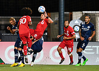LAKE BUENA VISTA, FL - JULY 26: Marco Delgado of Toronto FC wins a header as he is falling down during a game between New York City FC and Toronto FC at ESPN Wide World of Sports on July 26, 2020 in Lake Buena Vista, Florida.