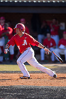 Armen Calilao (14) of the Belmont Abbey Crusaders follows through on his swing against the Shippensburg Raiders at Abbey Yard on February 8, 2015 in Belmont, North Carolina.  The Raiders defeated the Crusaders 14-0.  (Brian Westerholt/Four Seam Images)