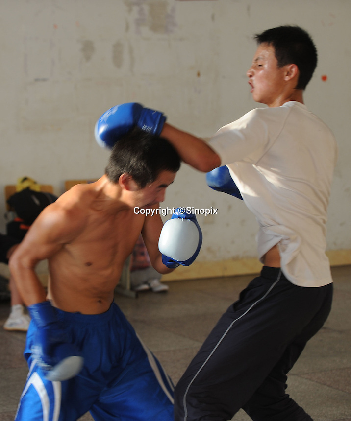 Miao Yun Fei, 16, in Huili Middle School in Sichuan Province, China. The group of young boxers are hoping to make it to become some of China's first professional boxers...PHOTO BY SINOPIX.