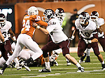 Texas Longhorns running back Demarco Cobbs (24) and Texas A&M Aggies defensive tackle Spencer Nealy (99) in action during the Texas A & M vs. Texas Longhorns football game at the Darrell K Royal - Texas Memorial Stadium in Austin, Tx. Texas A & M defeats Texas 24 to 17....