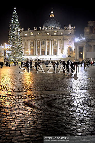 Pope Benedict XVI arrives to pray in front of the nativity in Saint Peter's Square after celebrating the Vespers and Te Deum prayers in Saint Peter's Basilica at the Vatican on December 31, 2010