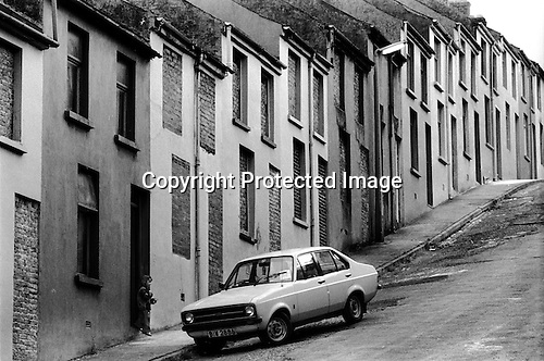 Derry, Northern Ireland. 1979<br /> One family remains in this Waterside street; houses area abandoned and boarded up as families moved away due to sectarian violence.<br /> <br /> For those that like to know these things I am advised this is a Ford Escort Mk2.