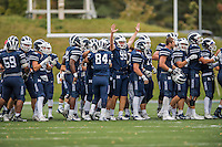 8 October 2016: Middlebury College Panther Kicker Carter Massengill, a Freshman from Summit, NJ, holds his hand up in celebration among his teammates after defeating the Amherst College Purple & White at Alumni Stadium in Middlebury, Vermont. The Panthers edged out the Purple & While 27-26. Mandatory Credit: Ed Wolfstein Photo *** RAW (NEF) Image File Available ***
