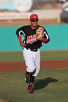 Edwin Garcia (24) of the High Desert Mavericks returns to the dugout during a game against the Inland Empire 66ers at Mavericks Stadium on May 6, 2015 in Adelanto, California. Inland Empire defeated High Desert, 10-4. (Larry Goren/Four Seam Images)