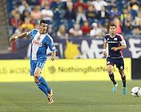 Philadelphia Union forward Sebastien Le Toux (11) redirects the ball. In a Major League Soccer (MLS) match, the New England Revolution (dark blue) defeated Philadelphia Union (light blue), 5-1, at Gillette Stadium on August 25, 2013.