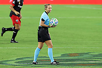NASHVILLE, TN - SEPTEMBER 23: Referee Tori Penso waits with the ball in the center circle before a game between D.C. United and Nashville SC at Nissan Stadium on September 23, 2020 in Nashville, Tennessee.