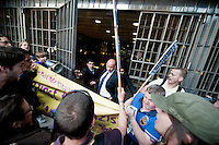 """Protesters chanting """"Hey, Ho, Richard Desmonds got to go!"""" scuffled with Police and security guards while trying to force their way into the offices of the Daily Express and Daily Star. They were complaining about a front page headline on the Express about gay asylum seekers which they claimed was racist and homophobic."""