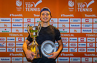 Alphen aan den Rijn, Netherlands, December 22, 2019, TV Nieuwe Sloot,  NK Tennis, Final men single:  Winner Tim van Rijthoven (NED) with the trophy<br /> Photo: www.tennisimages.com/Henk Koster