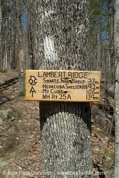 Smarts Mountain summit /cabin sign along the Appalachian Trail (Lambert Ridge Trail) in New Hampshire. A 41 foot steel tower is located on Smarts Mountain near the cabin. The tower was built in 1915.