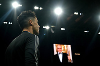 Cristiano Ronaldo of Juventus warms up while a portrait of the composer Ennio Morricone is displayed on the screen of the stadium prior to the Serie A football match between AC Milan and Juventus FC at stadio San Siro in Milan ( Italy ), July 7th, 2020. Ennio Morricone died today at age of 92. <br /> Photo Federico Tardito / Insidefoto
