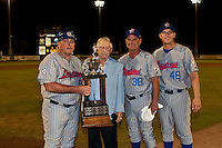 Florida State League President Chuck Murphy with Manager Buddy Bailey(L) #52,  Pitching Coach Tom Pratt #38, and Coach John Urick #48 after winning game 3 of the Florida State League Championship Series against the St. Lucie Mets to win the Florida State League Championship at Digital Domain Park on Spetember 11, 2011 in Port St. Lucie, Florida. Photo by Scott Jontes / Four Seam Images