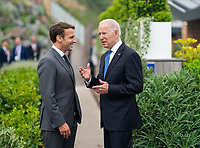 President Joe Biden and French President Emmanuel Macron talk prior to the first session of the G7 Summit on Friday, June 11, 2021, at the Carbis Bay Hotel and Estate in St. Ives, Cornwall, England. (Official White House Photo by Adam Schultz)
