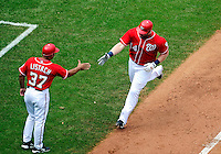 23 August 2009: Washington Nationals' first baseman Adam Dunn rounds the bases after hitting a home run against the Milwaukee Brewers at Nationals Park in Washington, DC. The Nationals defeated the Brewers 8-3 to take the third game of their four-game series, snapping a five games losing streak. Mandatory Credit: Ed Wolfstein Photo