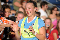 Chicago Red Star forward Ella Masar (3) is all smiles as she high fives fans after being taken out in the second half.  The  Chicago Red Stars defeated the Sky Blue FC 2-0 at Toyota Park in Bridgeview, IL on July 10, 2010.