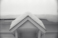 Snow covering roof of house<br />