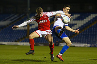 Fleetwood Town's Jack Sowerby (left) battles Bury's Callum Reilly (right)  during the The Checkatrade Trophy match between Bury and Fleetwood Town at Gigg Lane, Bury, England on 9 January 2018. Photo by Juel Miah/PRiME Media Images.