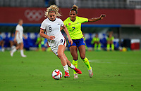 TOKYO, JAPAN - JULY 20: Lindsey Horan #9 of the United States turns and moves with the ball during a game between Sweden and USWNT at Tokyo Stadium on July 20, 2021 in Tokyo, Japan.
