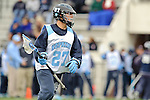Baltimore- February 4: Rob Guida of Hopkins charges toward the goal during the exhibition between Johns Hopkins and Penn State at Homewood Field on February 04, 2012 in Baltimore, MD.