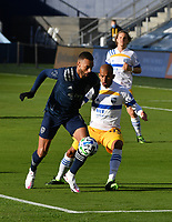KANSAS CITY, KS - NOVEMBER 22: Khiry Shelton #11 of Sporting KC tries to get a shot off in the box as Judson #93 of the San Jose Earthquakes tries to stop him before a game between San Jose Earthquakes and Sporting Kansas City at Children's Mercy Park on November 22, 2020 in Kansas City, Kansas.