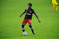 WASHINGTON, DC - OCTOBER 28: Oniel Fisher #91 of D.C. United moves the ball during a game between Columbus Crew and D.C. United at Audi Field on October 28, 2020 in Washington, DC.