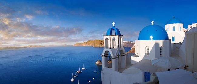 Panoramic of blue domed Greek Orthodox church of Oia, Santorini ( Thira ) Island, Greece.