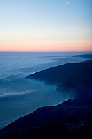 aerial photograph of Big Sur, California at dusk as fog approaches the Pacific coast, Monterey county