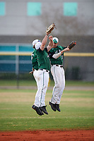 Dartmouth Big Green Ben Socher (26), Trevor Johnson (36) and Matt Feinstein (23) celebrate after the final out of a game against the Southern Maine Huskies on March 23, 2017 at Lake Myrtle Park in Auburndale, Florida.  Dartmouth defeated Southern Maine 9-1.  (Mike Janes/Four Seam Images)
