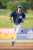 Sam Hilliard (25) of the Asheville Tourists rounds the bases after hitting a home run against the Kannapolis Intimidators at Kannapolis Intimidators Stadium on May 26, 2016 in Kannapolis, North Carolina.  The Tourists defeated the Intimidators 9-6 in 11 innings.  (Brian Westerholt/Four Seam Images)