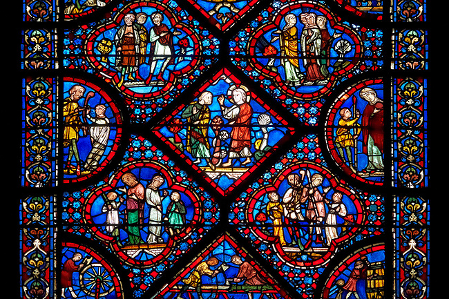 Medieval stained glass Window of the Gothic Cathedral of Chartres, France - dedicated to Noah and The Flood.Central Diamond panel - God instructs Noah to build an ark - The two panels below and the panels left and right show God instructing Noah to build an ark . Panel top left - Noah's sons; Shem, Ham and Japheth, panel top right - Noah's wife and daughters in law  .A UNESCO World Heritage Site..