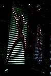 Large video displays of dancing girls come down during Bon Jovi 's performance of Bad Medicine.