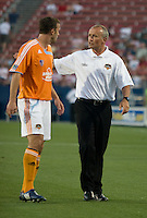 Houston Dynamo Head Coach Dominic Kinnear talks to his defender, Eddie Robinson (2) as they leave the field at the end of the first half trailing FC Dallas 1-0. Houston Dynamo vs FC Dallas at Pizza Hut Park in Frisco, Texas May-28-2008. Final Score 2-2