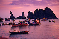Fishing boats at Quong Beach toward Hon Phu Tu rock formations Mekong Delta Vietnam.