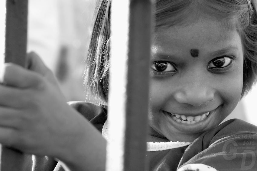 The view from my cat window,happy child looking central Mumbai,India