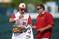 North Carolina State Wolfpack assistant director of sports medicine Anthony Sandersen attends to Evan Mendoza (18) in the game against the Boston College Eagles in Game Two of the 2017 ACC Baseball Championship at Louisville Slugger Field on May 23, 2017 in Louisville, Kentucky. The Wolfpack defeated the Eagles 6-1. (Brian Westerholt/Four Seam Images)
