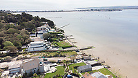 BNPS.co.uk (01202) 558833. <br /> Pic: CorinMesser/BNPS<br /> <br /> Pictured: The development site at Dorset Lake Avenue in Poole, Dorset opens onto Poole Harbour by the Sandbanks Peninsula. <br /> <br /> A wealthy homeowner has made the 'brave' decision to demolish his £6m seaside mansion that has its own indoor pool, gym and cinema. <br /> <br /> Ashley Faull has flattened the 20-year-old luxury house to build nine new flats to meet the increasing demand for housing that has led to a surge in property prices.<br /> <br /> The apartments will be priced between £1.495m to £2.8m.<br /> <br /> The now ruined four-storey and 19-room home sits on a half-an-acre plot that backs on to Poole Harbour and overlooks exclusive Sandbanks in Dorset.