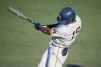 Michigan Wolverines outfielder Clark Elliott (15) swings the bat during the NCAA baseball tournament against the Connecticut Huskies on June 4, 2021 at Frank Eck Stadium in Notre Dame, Indiana. The Huskies defeated the Wolverines 6-1. (Andrew Woolley/Four Seam Images)