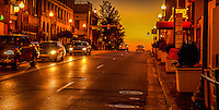 Memphis Tennessee, Street scenic sunset  photograph. Cars driving down the street.<br /> The city is located on the confluence of the Wolf and Mississippi rivers. Downtown Memphis and metro area spread out through suburbanization, and encompass southwest Tennessee, northern Mississippi and eastern Arkansas. Several large parks were founded in the city in the early 20th century
